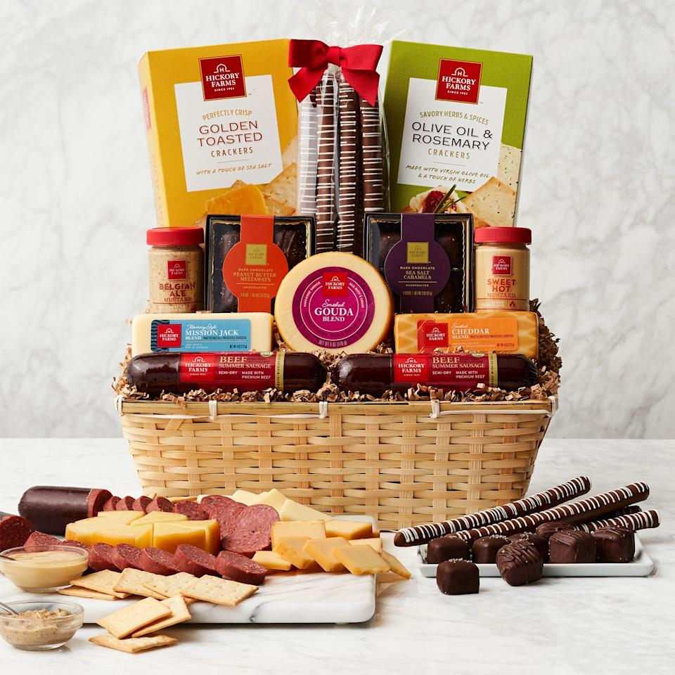 """<p>Christmas is right around the corner, which means the time has come to eat, drink, and be merry! This year, there's no better way to do so than with one of these delicious food gift baskets. </p><p><a href=""""https://www.thepioneerwoman.com/holidays-celebrations/gifts/g33416427/diy-christmas-gifts/"""" rel=""""nofollow noopener"""" target=""""_blank"""" data-ylk=""""slk:Christmas gift"""" class=""""link rapid-noclick-resp"""">Christmas gift</a> shopping can be tricky. But you really can't go wrong with a store-bought or <a href=""""https://www.thepioneerwoman.com/holidays-celebrations/gifts/g34362654/homemade-christmas-food-gifts/"""" rel=""""nofollow noopener"""" target=""""_blank"""" data-ylk=""""slk:homemade Christmas food gift"""" class=""""link rapid-noclick-resp"""">homemade Christmas food gift</a>! Brimming with mouthwatering savory and sweet treats, these edible arrangements make excellent <a href=""""https://www.thepioneerwoman.com/holidays-celebrations/gifts/g32503661/christmas-gift-ideas-for-her/"""" rel=""""nofollow noopener"""" target=""""_blank"""" data-ylk=""""slk:gifts for her"""" class=""""link rapid-noclick-resp"""">gifts for her</a>, gifts for husbands, or <a href=""""https://www.thepioneerwoman.com/holidays-celebrations/gifts/g32161232/best-friend-gifts/"""" rel=""""nofollow noopener"""" target=""""_blank"""" data-ylk=""""slk:gifts for best friends"""" class=""""link rapid-noclick-resp"""">gifts for best friends</a>. They're also the perfect host or <a href=""""https://www.thepioneerwoman.com/home-lifestyle/entertaining/g32293314/hostess-gifts-ideas/"""" rel=""""nofollow noopener"""" target=""""_blank"""" data-ylk=""""slk:hostess gift"""" class=""""link rapid-noclick-resp"""">hostess gift</a> to send just ahead of their big celebration. Everyone will love munching on these snacks while Christmas dinner is cooking! </p><p>There's a food gift basket for everyone on this list—choose from meat and cheese baskets, fruit baskets, chocolate baskets, or cookie baskets. Some picks even come with wine to keep the holiday fun flowing. And just because these gift baskets are store-bought, doesn't mean"""