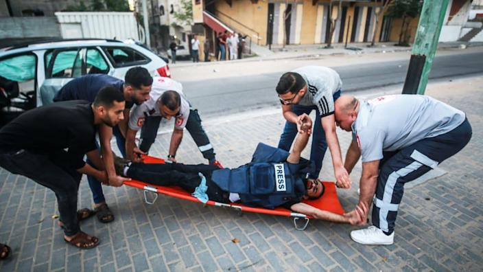 """<div class=""""inline-image__title"""">1232871209</div> <div class=""""inline-image__caption""""><p>Anadolu Agency's cameraman Mohammad al-Aloul is carried to hospital after being hit by an Israeli strike.</p></div> <div class=""""inline-image__credit"""">Mustafa Hassona/Anadolu Agency/Getty</div>"""