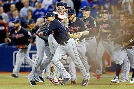 The Cleveland Indians celebrate beating the Toronto Blue Jays in game five of the 2016 ALCS playoff baseball series at Rogers Centre. Mandatory Credit: John E. Sokolowski-USA TODAY Sports