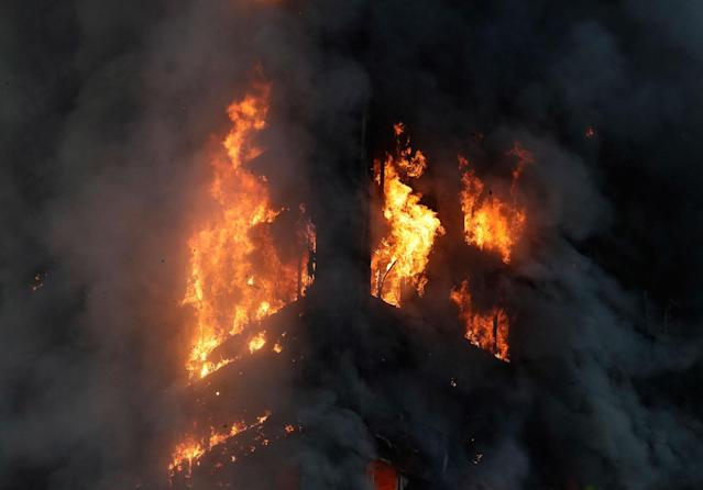 <p>Smoke and flames rise from a building on fire in London, Wednesday, June 14, 2017. Metropolitan Police in London say they're continuing to evacuate people from a massive apartment fire in west London. The fire has been burning for more than three hours and stretches from the second to the 27th floor of the building. (AP Photo/Matt Dunham) </p>