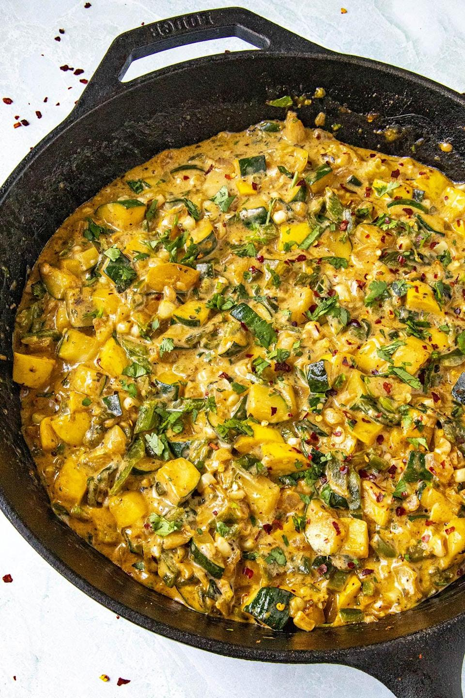 "<p>Looking for something filled with flavor? This calabacitas recipe has all that and more. It's made with sautéed zucchini, roasted peppers, onions, and cheese, so you'll be drooling before it's even done cooking.</p> <p><strong>Get the recipe</strong>: <a href=""https://www.chilipeppermadness.com/recipes/calabacitas/"" class=""link rapid-noclick-resp"" rel=""nofollow noopener"" target=""_blank"" data-ylk=""slk:calabacitas"">calabacitas</a></p>"