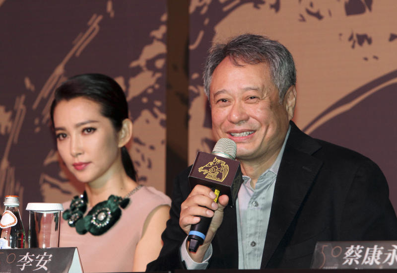 Taiwanese director Ang Lee, right, answers a reporter's question as Chinese actress Li Bing Bing, left, listens during a media event for the 50th Golden Horse Awards in Taipei, Taiwan, Tuesday, Nov. 12, 2013. Academy Award-winning director Ang Lee believes the modest clout of the premier awards for Chinese-language films will grow as the market for such films increases. (AP Photo/Chiang Ying-ying)