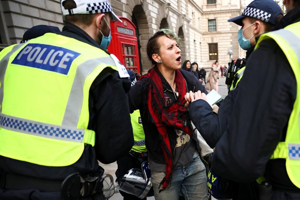 <p>Police hancuffed protesters as they marched through the streets of London</p>REUTERS