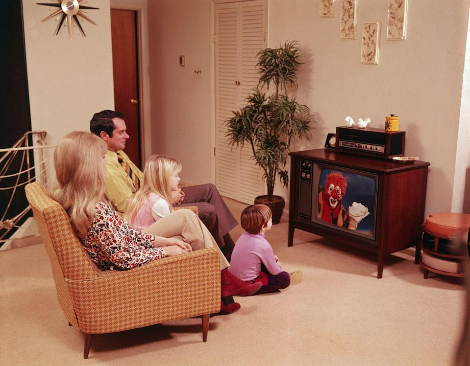 """<p>Televisions weren't always so flat and light they could hang on walls. In the 70s they were <em>furniture</em>, a place to put knickknacks as well as watch <em><a href=""""https://www.countryliving.com/life/entertainment/g28965566/the-brady-bunch-cast-now/"""" rel=""""nofollow noopener"""" target=""""_blank"""" data-ylk=""""slk:The Brady Bunch."""" class=""""link rapid-noclick-resp"""">The Brady Bunch.</a></em></p>"""