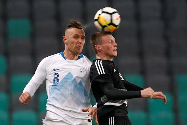 Soccer Football - International Friendly - Slovenia vs Belarus - Stozice Stadium, Ljubljana, Slovenia - March 27, 2018 Belarus' Yuri Kovalev in action with Slovenia's Jasmin Kurtic REUTERS/Borut Zivulovic