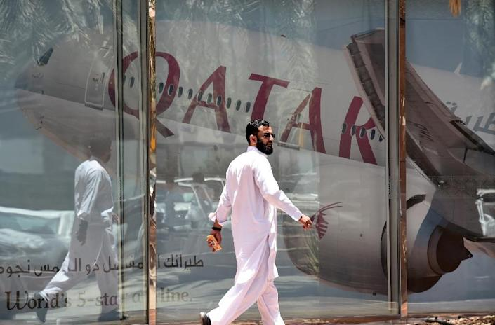 Egypt said it would end visas on arrival for Qatari citizens as a dispute between four Arab states and the Gulf emirate continues over allegations that Doha supports terrorism (AFP Photo/FAYEZ NURELDINE)