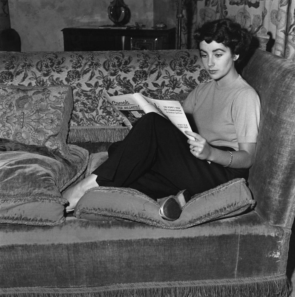 <p>Elizabeth dresses comfortably as she curls up on her sofa for a quiet moment of reading. </p>