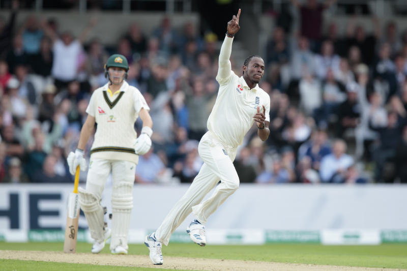England's Jofra Archer celebrates after taking the wicket of Australia's David Warner caught by Jonny Bairstow for 61 on the first day of the 3rd Ashes Test cricket match between England and Australia at Headingley cricket ground in Leeds, England, Thursday, Aug. 22, 2019. (AP Photo/Jon Super)