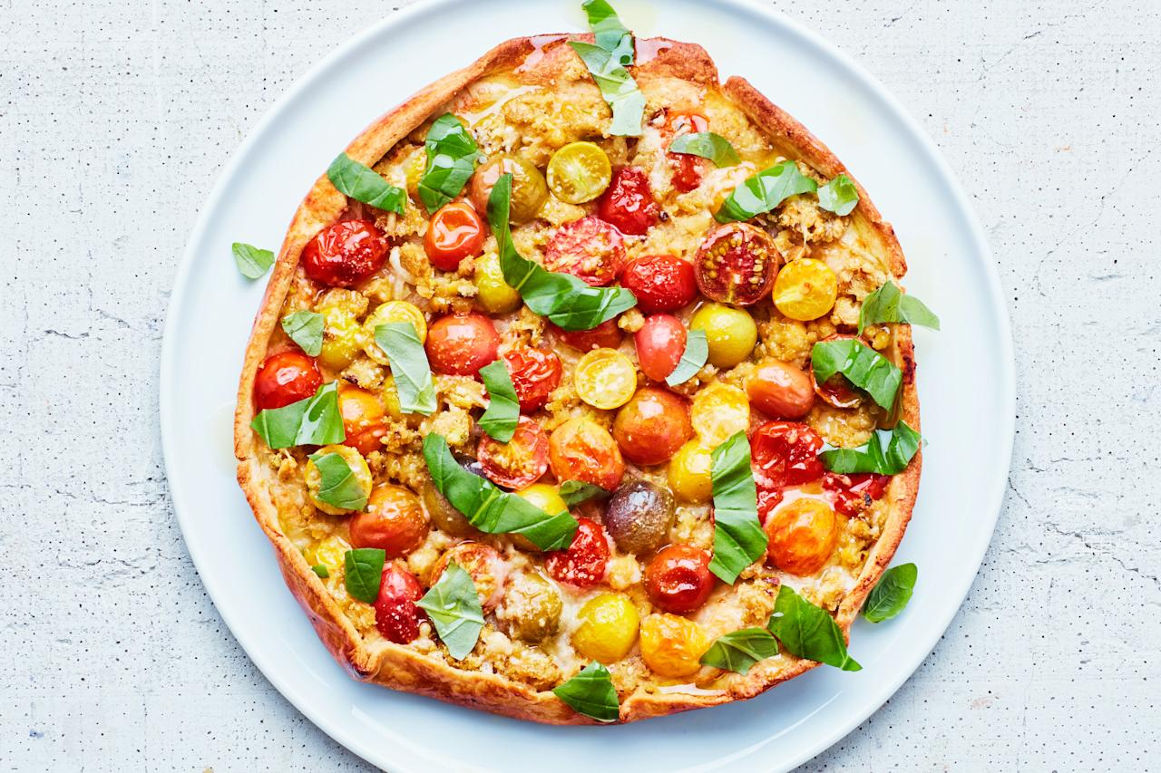 """A combination of pistachios and chickpeas adds filling protein and rich flavor in this update on the classic summery tomato tart. One tart with a <a href=""""http://www.epicurious.com/recipes/food/views/watercress-salad-with-mustard-vinaigrette?mbid=synd_yahoo_rss"""">pretty side salad</a> makes a simple dinner for two, but it's easy to double the recipe and make two tarts for a larger group. <a href=""""https://www.epicurious.com/recipes/food/views/tomato-tart-with-chickpea-crumble?mbid=synd_yahoo_rss"""">See recipe.</a>"""