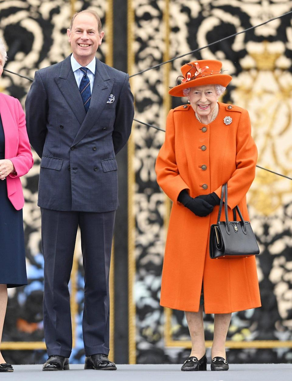 Prince Edward, Earl of Wessex and Queen Elizabeth II officially launch the Birmingham 2022 Queen's Baton Relay for the XXII Commonwealth Games at Buckingham Palace on October 07, 2021 in London, England