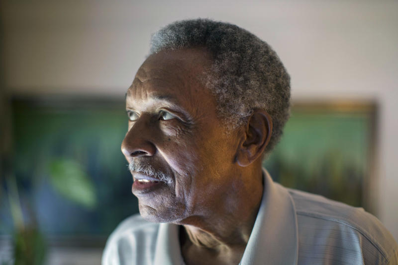 In this June 20, 2013 photo, Otis McDonald, 79, looks out the window of his home on Chicago's South Side. McDonald was one of the plaintiffs in the lawsuit that ended with the U.S. Supreme Court tossing out Chicago's ban on having guns even in your home three years ago. As Illinois Gov. Pat Quinn mulls whether to sign off on eliminating the nation's last ban on public possession of guns, the question in Chicago is whether it will matter in the crime-weary city where a spiking murder rate drew national attention last year. McDonald is in that segment of Chicagoans who believes more guns will allow people to defend themselves better. (AP Photo/Scott Eisen)