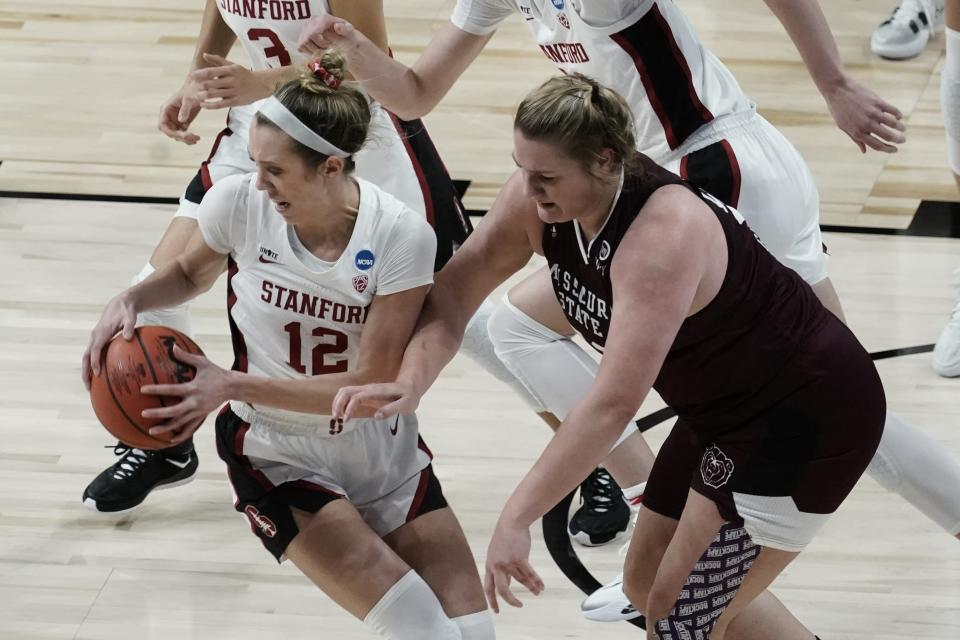 Stanford's Lexie Hull grabs a loose ball in front of Missouri State's Emily Gartner during the second half of an NCAA college basketball game in the Sweet 16 round of the Women's NCAA tournament Sunday, March 28, 2021, at the Alamodome in San Antonio. (AP Photo/Morry Gash)