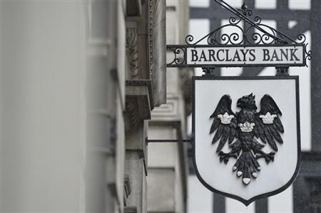 A logo hangs outside a branch of Barclays bank in London July 30, 2013. Barclays is raising 5.8 billion pounds ($8.9 billion) from its shareholders to help plug a larger-than-expected capital shortfall identified by Britain's financial regulator at the 320-year-old bank. REUTERS/Toby Melville
