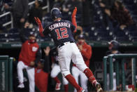 Washington Nationals' Kyle Schwarber celebrates his game-winning home run as he rounds the bases during the ninth inning of a baseball game against the Arizona Diamondbacks at Nationals Park, Friday, April 16, 2021, in Washington. The Nationals won 1-0. (AP Photo/Alex Brandon)