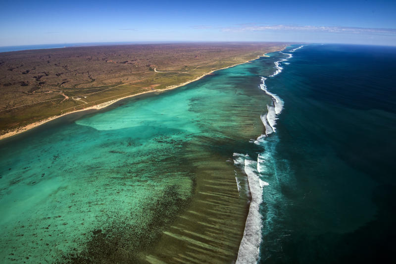 Aerial View of the Ningaloo Reef in Western Australia and the Cape Range National Park where the desert meets the sea from a birds eye view