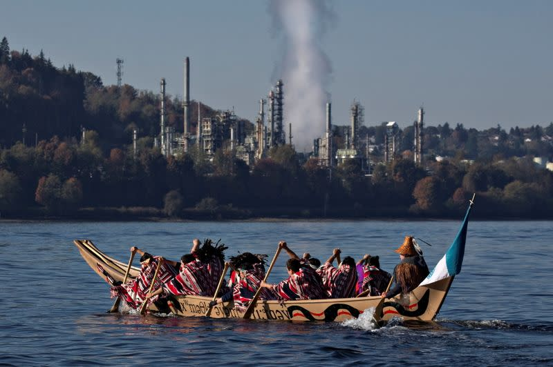 FILE PHOTO: First Nation Tsleil-Waututh, Squamish and Musqueam bands paddle in a canoe during a protest in North Vancouver