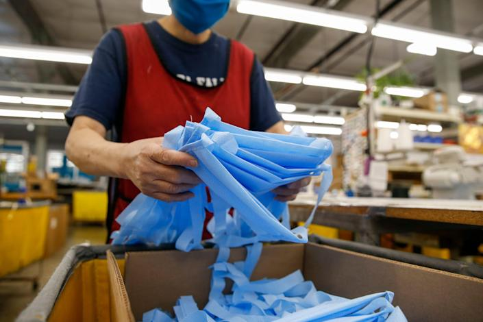 Completed face masks are packaged for shipping at the Tom Bihn factory in Seattle in March. Tom Bihn is a travel bag company that shifted production to face masks because of the COVID-19 outbreak.