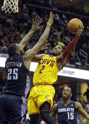 Kyrie Irving just got $90 million and LeBron. Pretty good week. (AP/Mark Duncan)