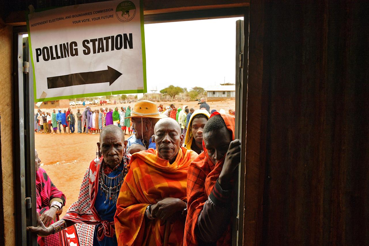 <p>Maasai voters queue at a polling station in Saikeri, Kajiado West County, Kenya on Aug. 8, 2017. (Photo: Carl de Souza/AFP/Getty Images) </p>