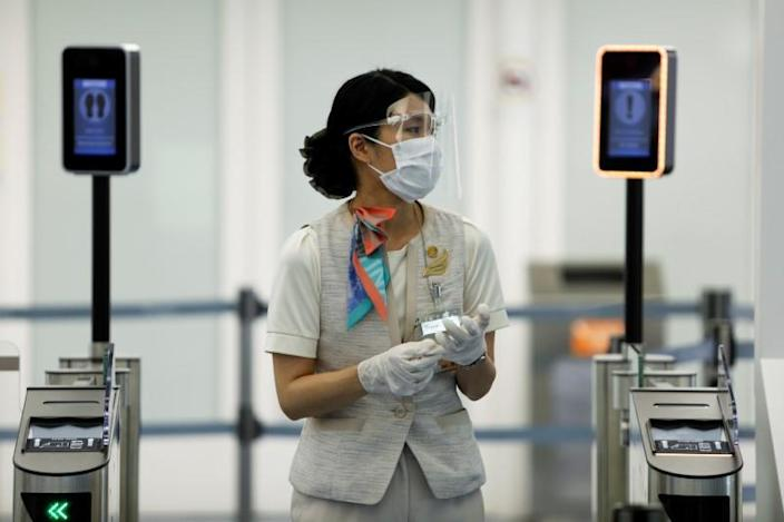 FILE PHOTO: An airport staff member stands at the Haneda airport in Tokyo