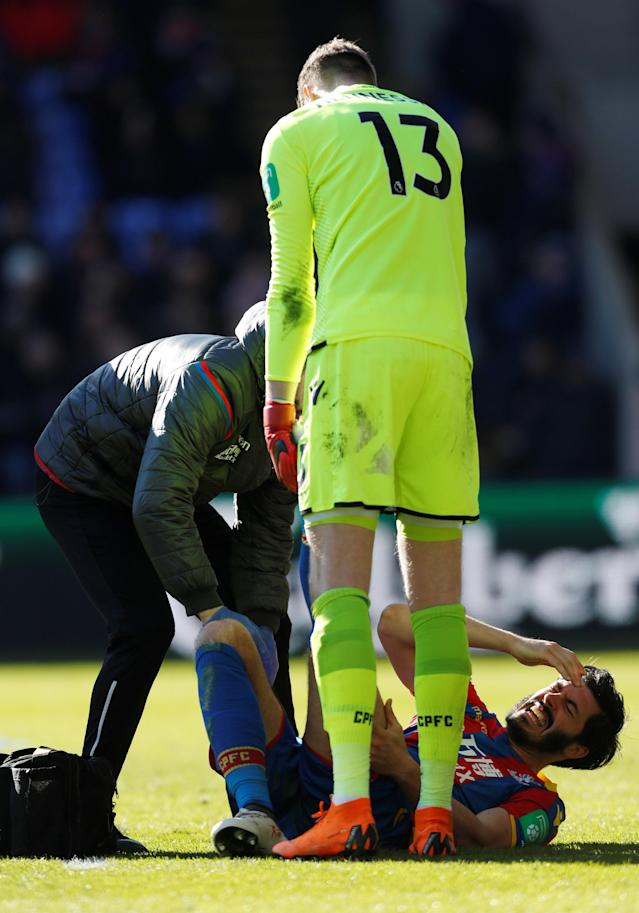 "Soccer Football - Premier League - Crystal Palace vs Tottenham Hotspur - Selhurst Park, London, Britain - February 25, 2018 Crystal Palace's James Tomkins receives medical attention after sustaining an injury Action Images via Reuters/Paul Childs EDITORIAL USE ONLY. No use with unauthorized audio, video, data, fixture lists, club/league logos or ""live"" services. Online in-match use limited to 75 images, no video emulation. No use in betting, games or single club/league/player publications. Please contact your account representative for further details."