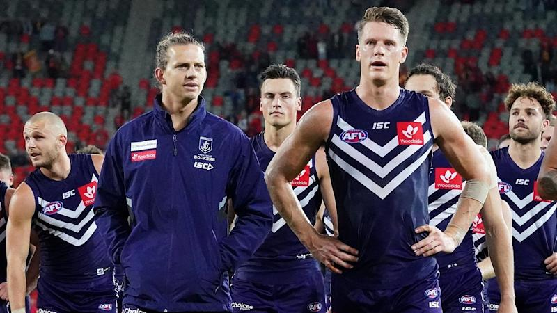 Skipper Nat Fyfe (2L) has injured his hamstring as Fremantle's winless AFL season continues
