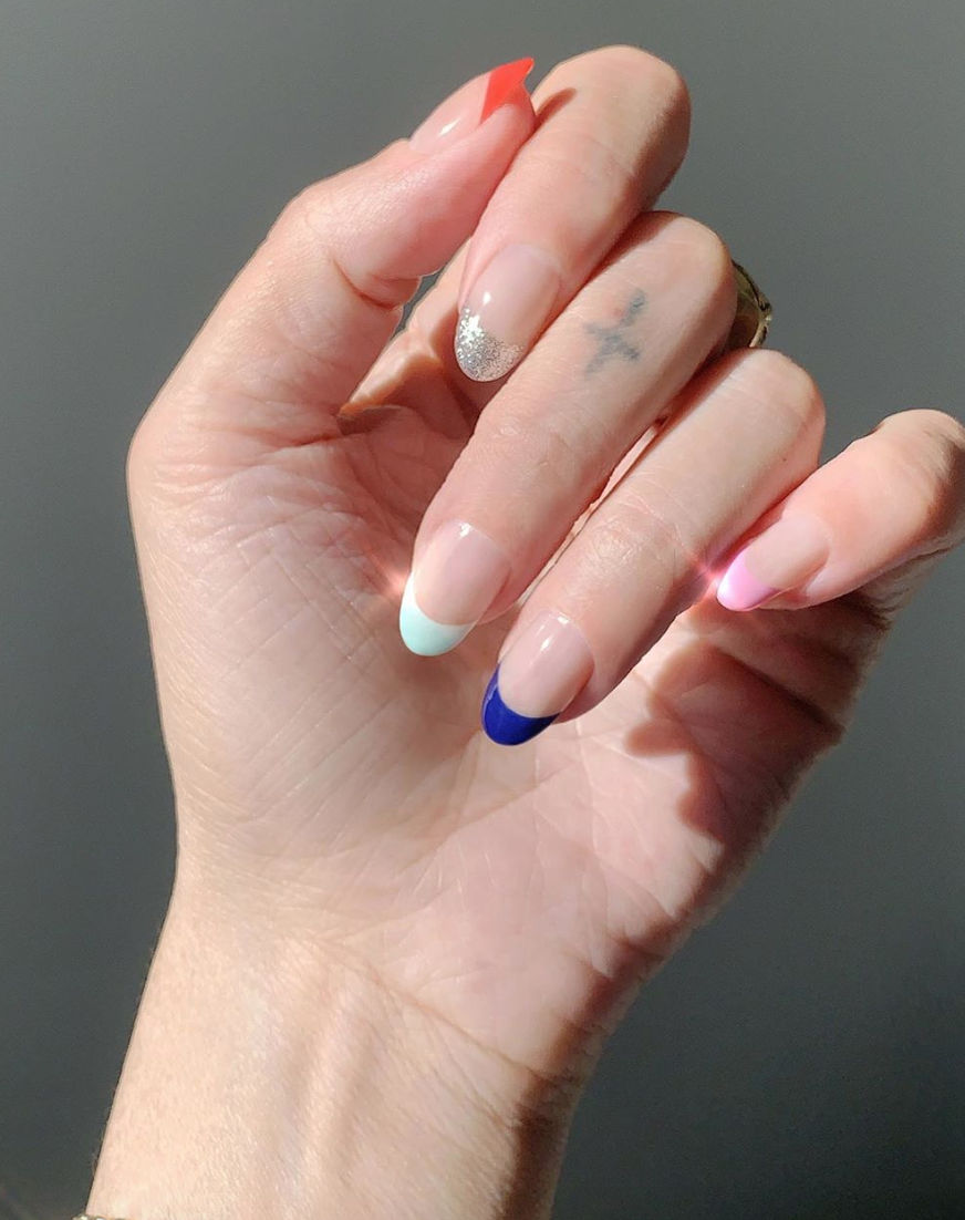 Make a French mani a little cooler with a different color tip on each finger.