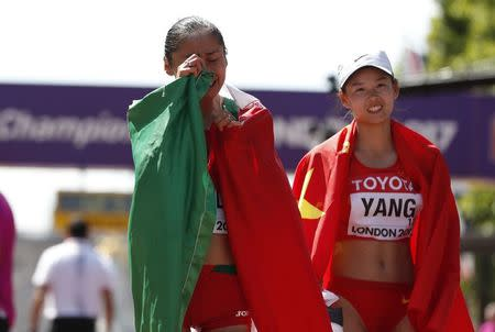 Athletics - World Athletics Championships – women's 20 km walk – London Stadium, London, Britain – August 13, 2017 – Maria Guadalupe Gonzalez of Mexico and Jiayu Yang of China celebrates wining silver and gold medals. REUTERS/Matthew Childs