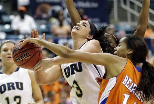 Oral Roberts' Taylor Cooper (3) is fouled by Sam Houston State's Clarke Davis, right, during the first half of the Southland Conference championship NCAA college basketball game, Saturday, March 16, 2013, in Katy, Texas. (AP Photo/David J. Phillip)