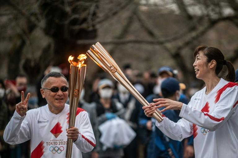 The torch relay began from Fukushima on March 25, with organisers hoping it will help build enthusiasm for the Games across Japan