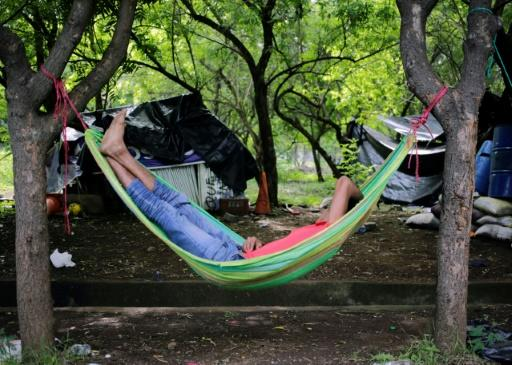 A student sleeps in a hammock after a night of clashes with members of the Sandinista youth and police