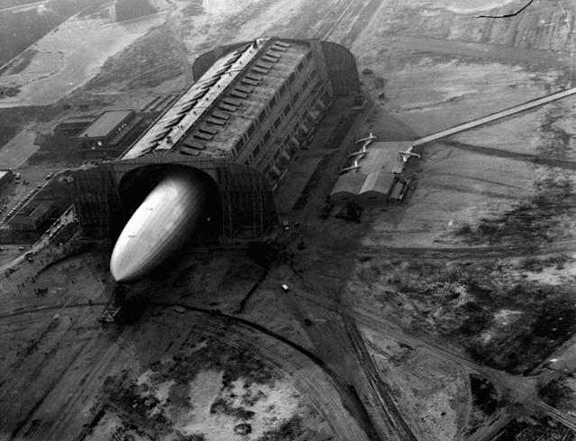 <p>The German zeppelin Hindenburg, its nose hooked to a mooring mast, is guided into a U.S. Navy dirigible hangar in Lakehurst, NJ, May 9, 1936, after the first leg of 10 scheduled round trips between Germany and the U.S. (AP Photo/Joe Caneva) </p>