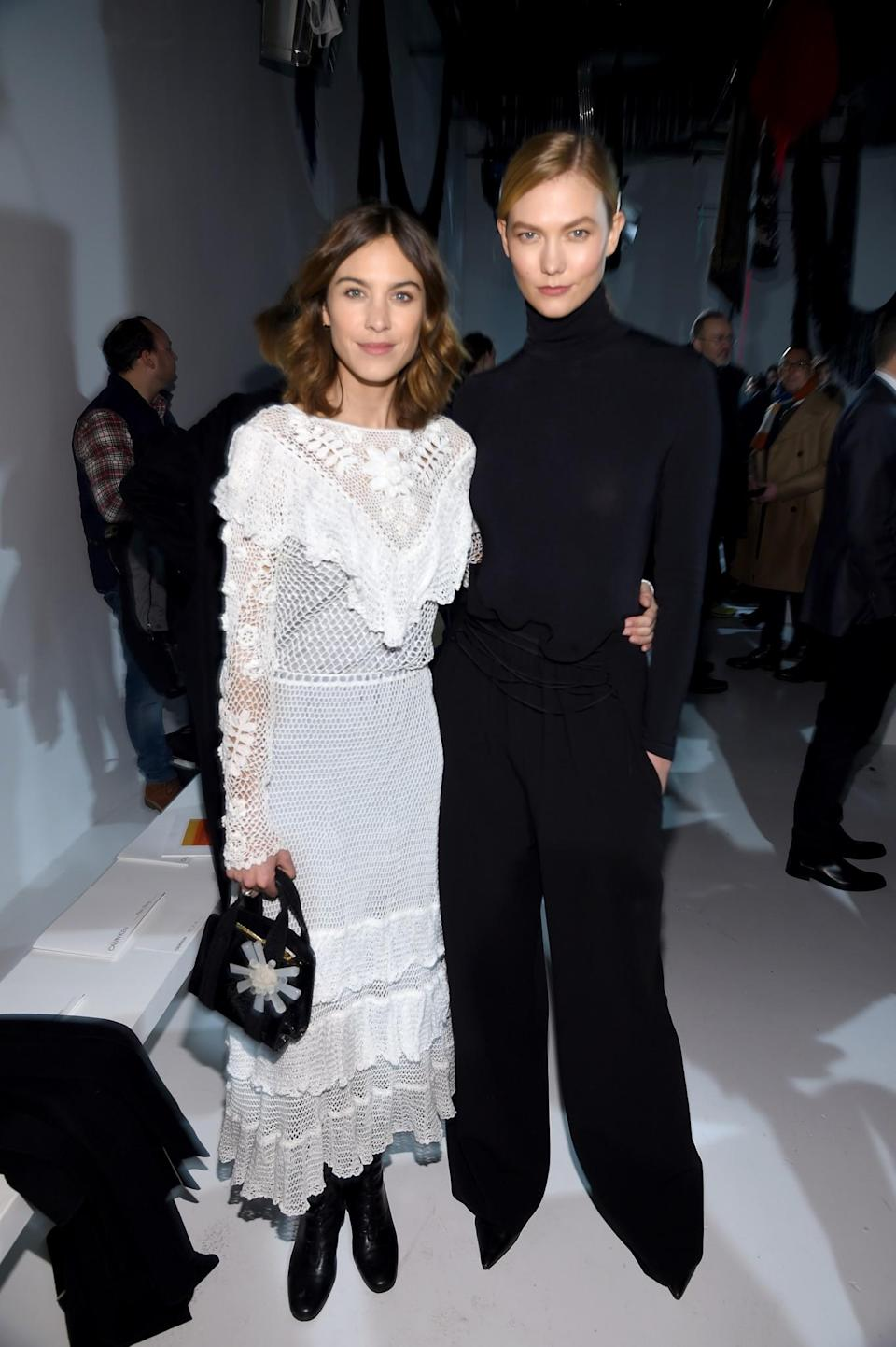 <p>Alexa Chung and Karlie Kloss were the complete opposite with Alexa dressed in a white crochet dress and Karlie wearing a sleek black look. <i>[Photo: Getty]</i> </p>