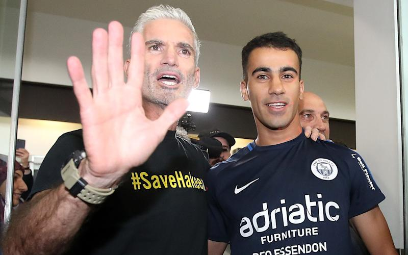 Craig Foster and Hakeem Al-Araibi atMelbourne Airport on Tuesday - 2019 Getty Images