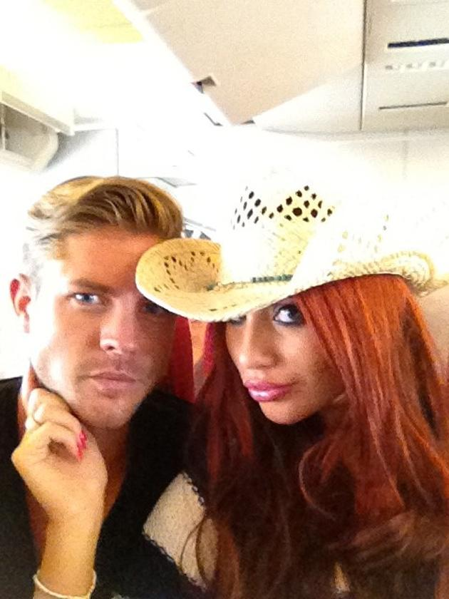 Celebrity photos: Amy Childs and her new boyfriend, David Peters have been spending a lot of time looking very loved up lately. And now they've taken their romance to the next level by jetting off on their first holiday together. Amy tweeted this photo of the pair on the way to the airport.