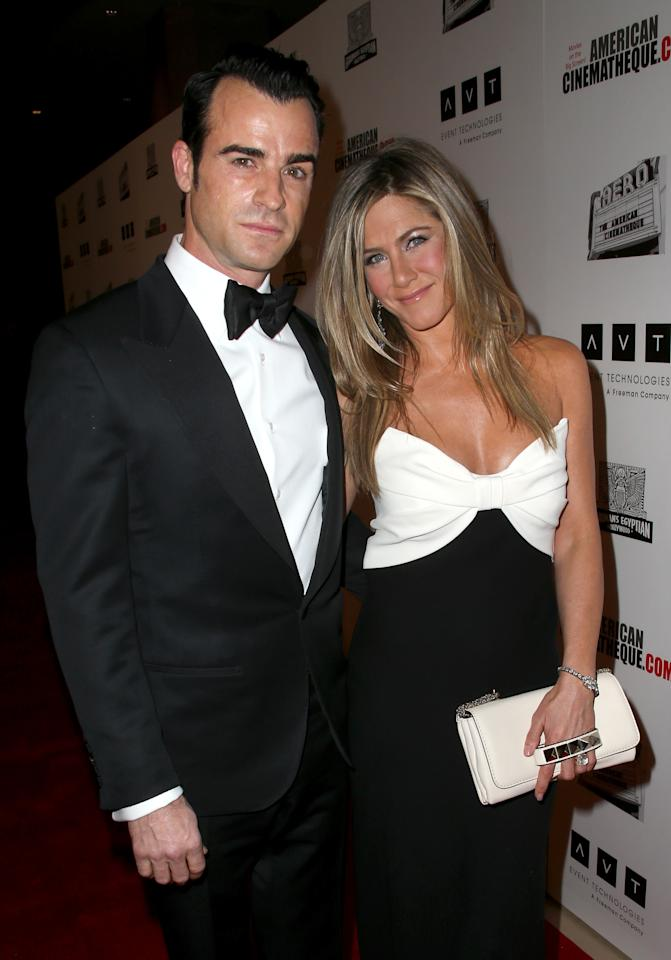 BEVERLY HILLS, CA - NOVEMBER 15:  Actor Justin Theroux (L) and actress Jennifer Aniston attend the 26th American Cinematheque Award Gala honoring Ben Stiller at The Beverly Hilton Hotel on November 15, 2012 in Beverly Hills, California.  (Photo by Frederick M. Brown/Getty Images)