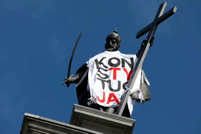 FILE PHOTO: Statue of the King Sigismund at the Old Town, is seen dressed up in a T-shirt with the slogan 'Constitution' in Warsaw