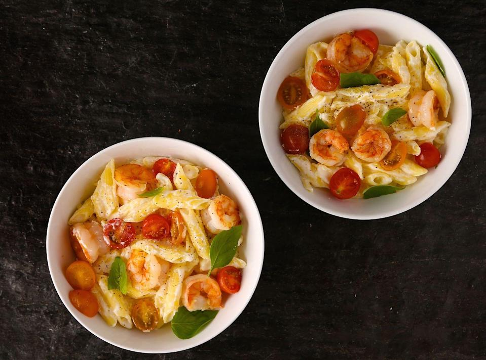 """<p>The sauce is amazingly creamy, and so simple.</p><p>Get the recipe from <a href=""""https://www.delish.com/cooking/recipe-ideas/recipes/a42718/penne-garlicky-shrimp-ricotta-tomatoes/"""" rel=""""nofollow noopener"""" target=""""_blank"""" data-ylk=""""slk:Delish"""" class=""""link rapid-noclick-resp"""">Delish</a>.<br></p>"""