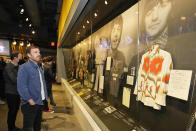Caleb Followill looks at a Beatles display at the Rock and Roll Hall of Fame Thursday, April 29, 2021, in Cleveland. Rockers Kings of Leon tour a new digital exhibit at the Rock and Roll Hall of Fame for the NFT (cryptocurrency) launching before the rock band plays at the NFL draft, Thursday, April 29, 2021, in Cleveland. (AP Photo/Tony Dejak)