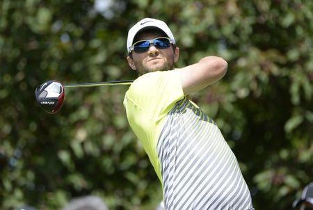 Kyle Stanley tees off on the 9th hole during the first round of the RBC Canadian Open at Royal Montreal GC - Blue Course. Jul 24, 2014; Ile Bizard, Quebec, CAN; Eric Bolte-USA TODAY Sports