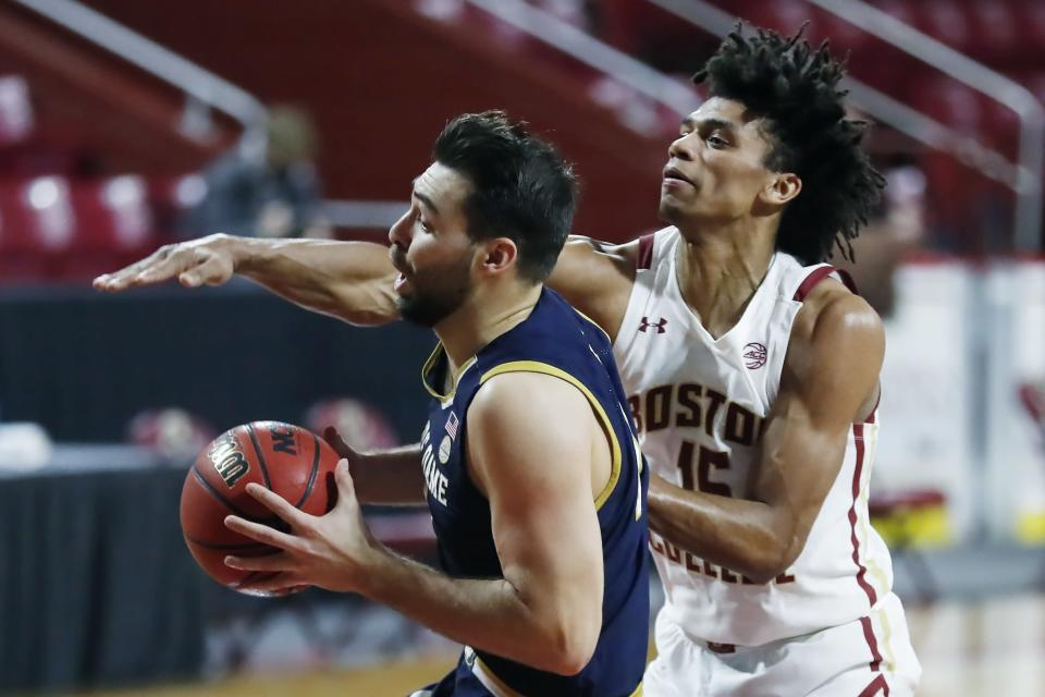 Boston College's Demarr Langford Jr. (15) defends against Notre Dame's Nikola Djogo during the first half of an NCAA college basketball game, Saturday, Feb. 27, 2021, in Boston. (AP Photo/Michael Dwyer)