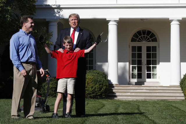 <p>Frank Giaccio, 11, of Falls Church, Va., holds his arms up in the air after being surprised by President Donald Trump, Friday, Sept. 15, 2017, while mowing the lawn of the Rose Garden at the White House in Washington. The 11-year-old, who wrote the president requesting to mow the lawn at the White House, was so focused on the job at hand the he didn't notice the president until he was right next to him. At left is Frank's father, Greg Giaccio. (Photo: Jacquelyn Martin/AP) </p>