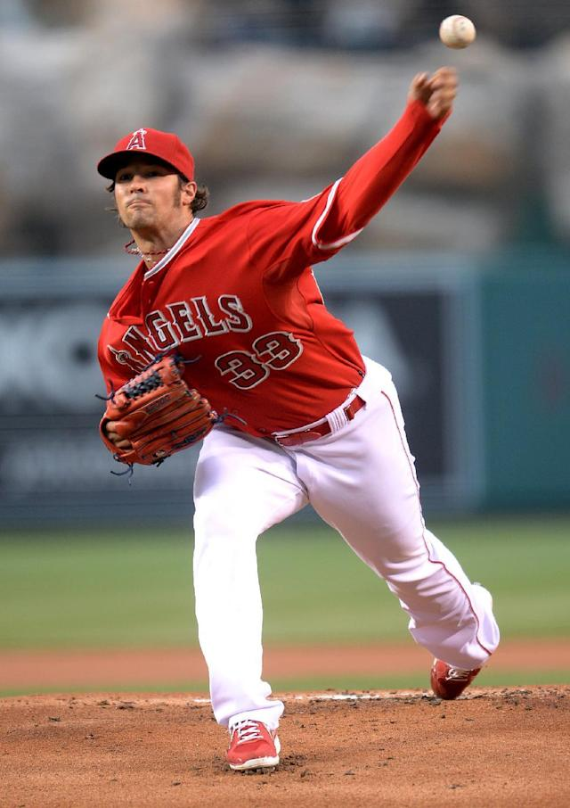 Los Angeles Angels pitcher C.J. Wilson delivers in the first inning of a baseball game against the New York Yankees, Tuesday, May 6, 2014, in Anaheim, Calif. (AP Photo/Jayne Kamin-Oncea)