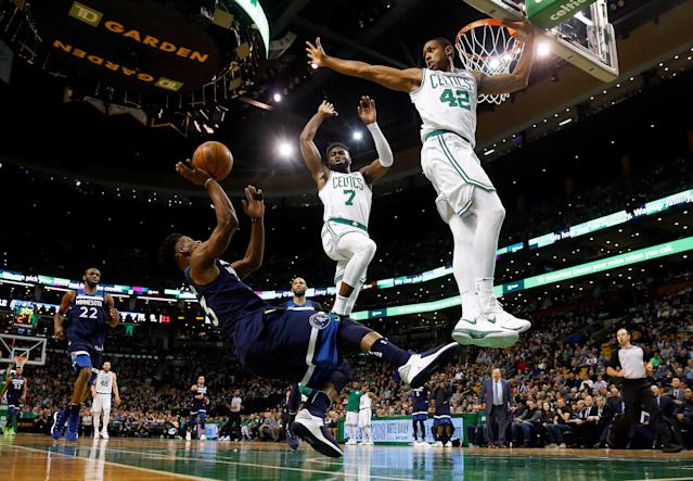 Jan 5, 2018; Boston, MA, USA; Minnesota Timberwolves guard Jimmy Butler (23) tries to shoot over Boston Celtics forward Al Horford (42) and guard Jaylen Brown (7) while falling during the first half at TD Garden. Mandatory Credit: Winslow Townson-USA TODAY Sports TPX IMAGES OF THE DAY