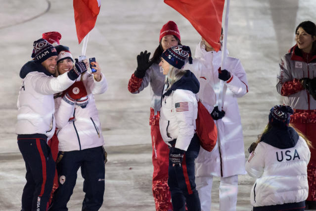 <p>Ester Ledecka of the Czech Republic, 2nd left, takes photos with U.S. athletes during the closing ceremony of the 2018 Winter Olympics in Pyeongchang, South Korea, Sunday, Feb. 25, 2018. (Jean-Christophe Bott/Keystone via AP) </p>