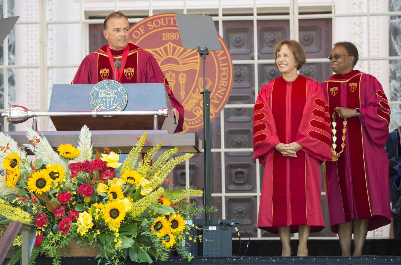 IMAGE DISTRIBUTED FOR USC -  Interim USC President Wanda Austin, right, and USC Board of Trustees Chair Rick Caruso, left, bestow USC President Carol L. Folt with the Medal of Office during her inauguration Friday Sept. 20, 2019 in Los Angeles. (Phil McCarten/AP Images for USC)