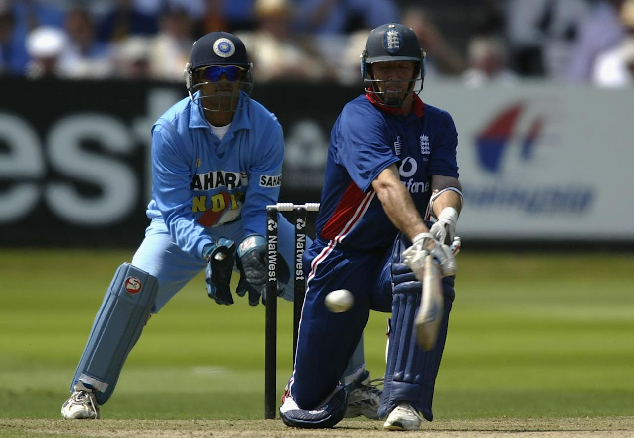 LONDON, ENGLAND - JULY 13:  Nasser Hussain of England sweeps the ball away during the match between England and India in the NatWest One Day Series Final at Lord's in London, England on July 13, 2002. (Photo by Clive Mason/Getty Images)