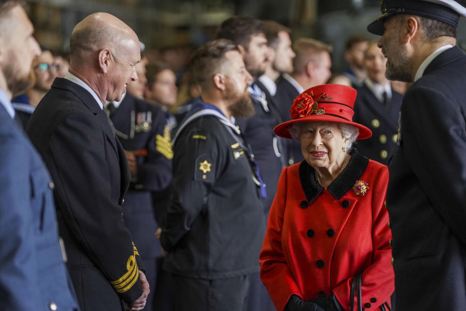 PORTSMOUTH, ENGLAND - MAY 22: Queen Elizabeth II during a visit to HMS Queen Elizabeth at HM Naval Base ahead of the ship's maiden deployment on May 22, 2021 in Portsmouth, England. The visit comes as HMS Queen Elizabeth prepares to lead the UK Carrier Strike Group on a 28-week operational deployment travelling over 26,000 nautical miles from the Mediterranean to the Philippine Sea. (Photo by Steve Parsons - WPA Pool / Getty Images)