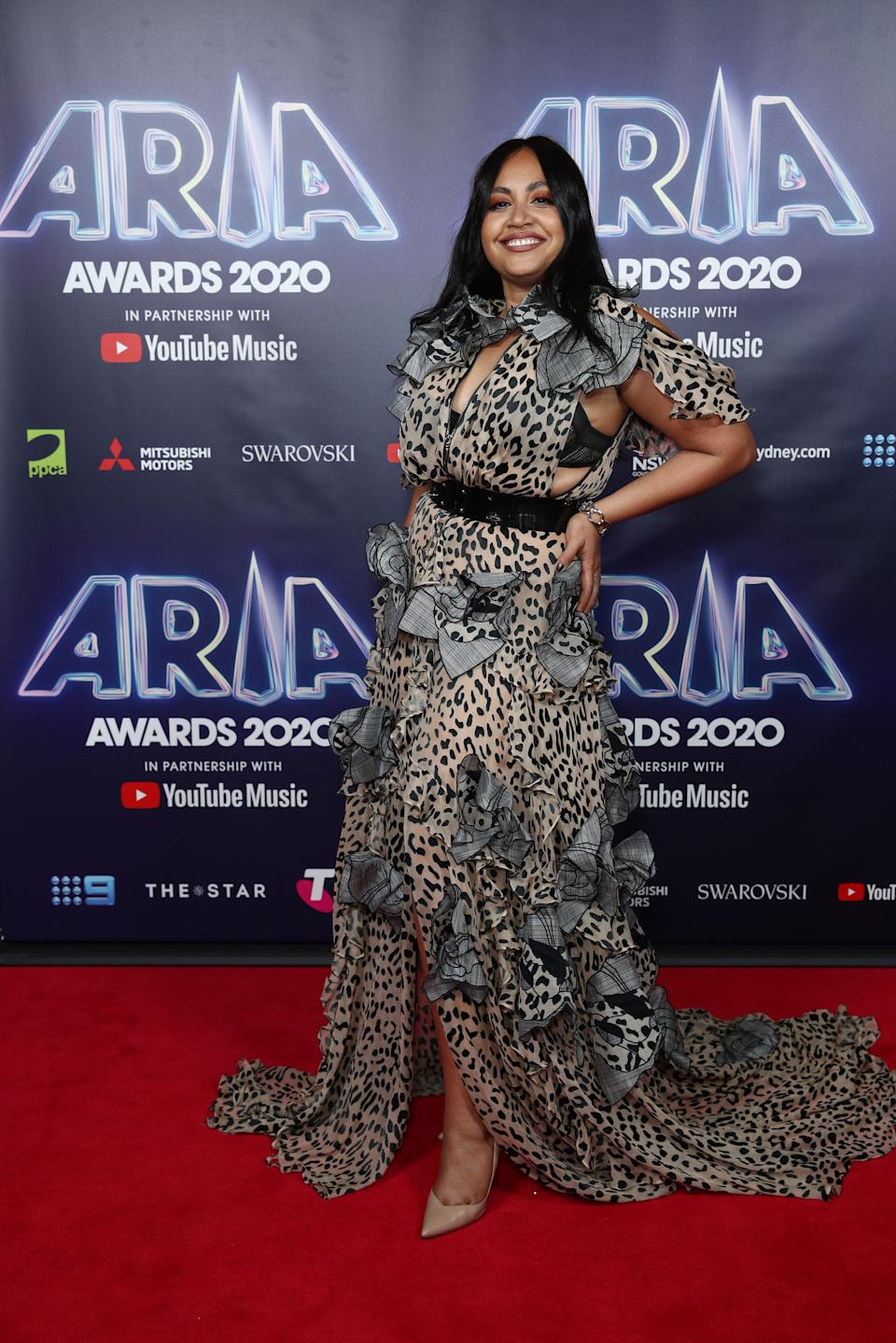 Jessica Mauboy wears a floor-length leopard print gown on the red carpet at the 2020 ARIA Awards at The Star on November 24, 2020 in Sydney, Australia.
