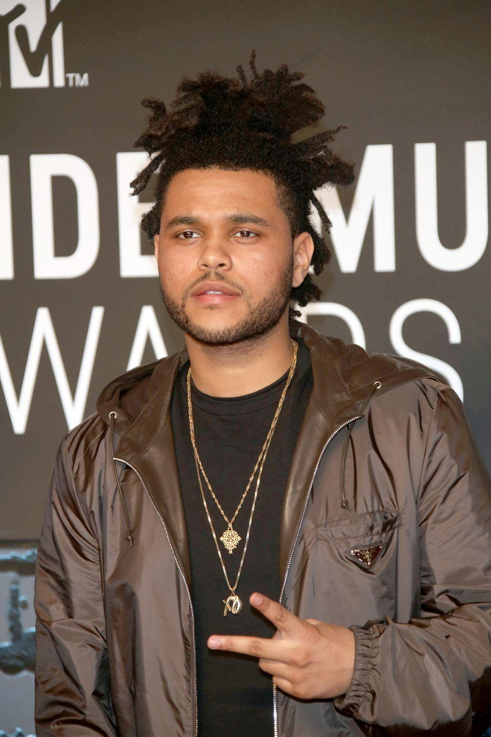 <p>The singer walked the red carpet of the MTV Music Video Awards wearing what become his signature look: locs and a goatee. </p>